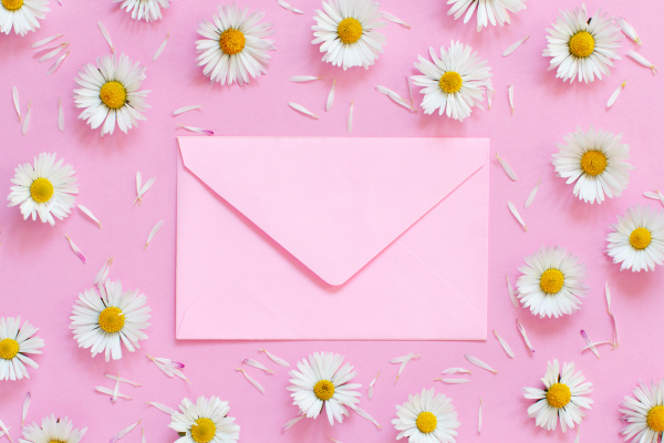 white daisies and an envelope on