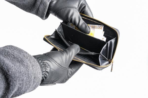 burglar tries to steals money from