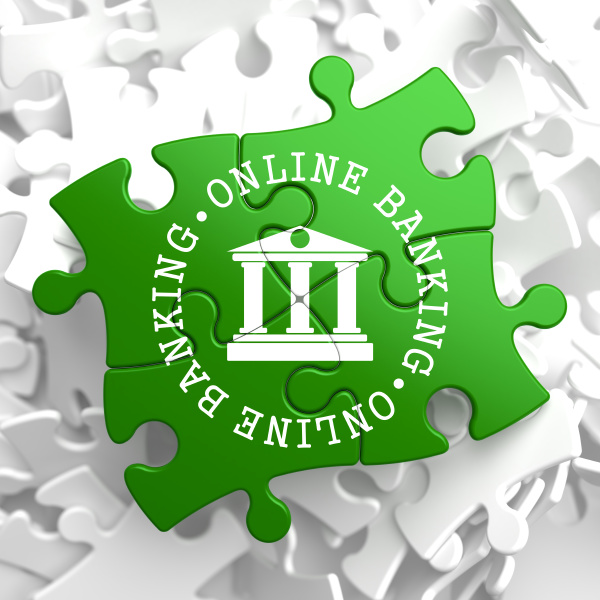online banking concept on green puzzle