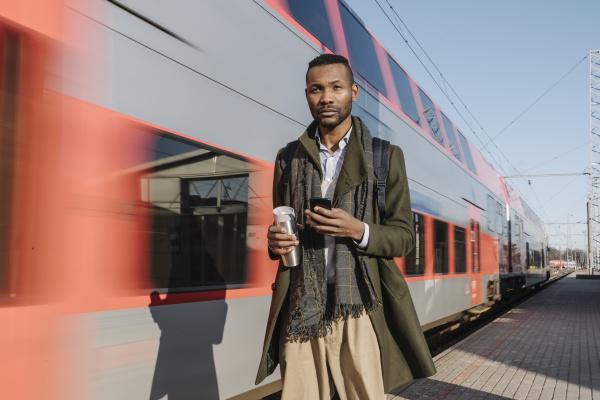 portrait of stylish man with smartphone