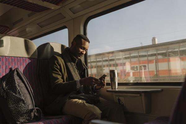 stylish man using smartphone inside a