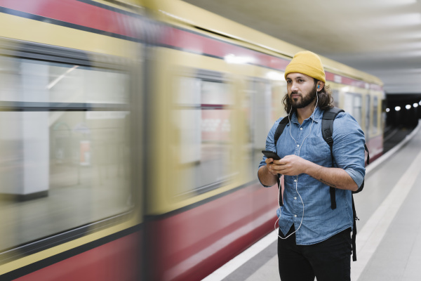 portrait of man listening music with