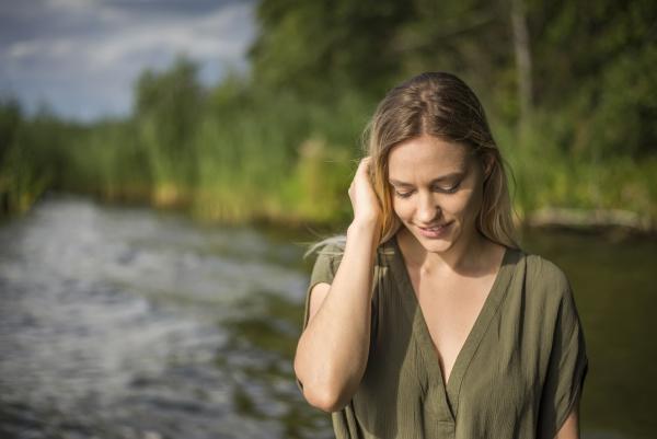 woman standing at a lake