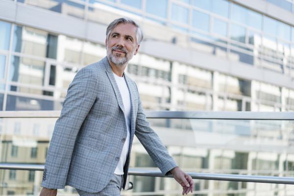 confident mature businessman on the go