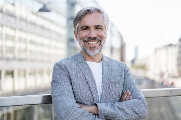 portrait of smiling fashionable mature businessman