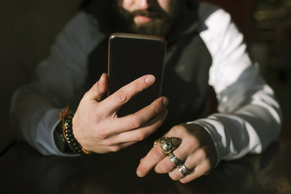 mans hands with smartphone