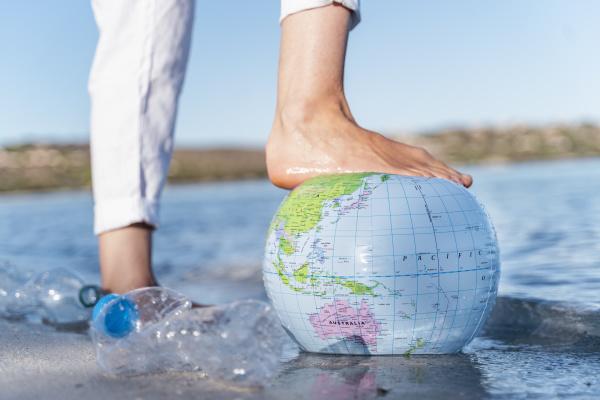 mans foot on earth beach ball