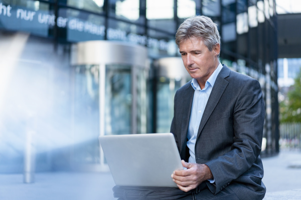 mature businessman using laptop in the