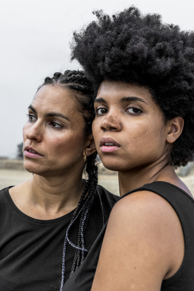 portrait of two women with black
