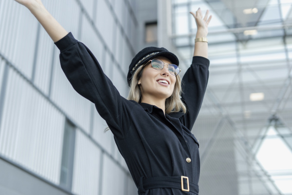 young blond businesswoman wearing black sailor