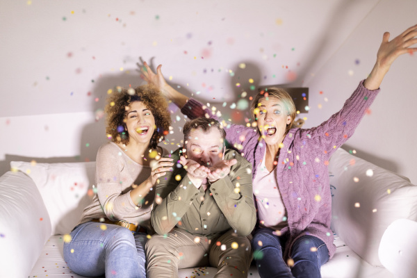 best friends celebrating party with confetti