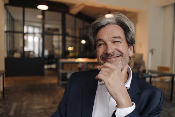 portait of smiling senior businessman in