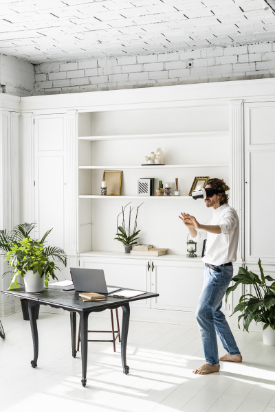 man at home using vr glasses