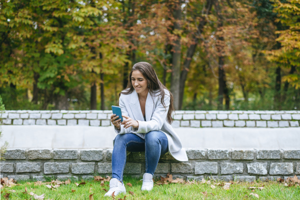 smiling woman using her smartphone in