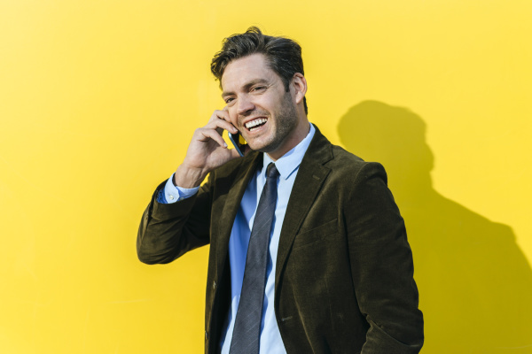 happy businessman on the phone in