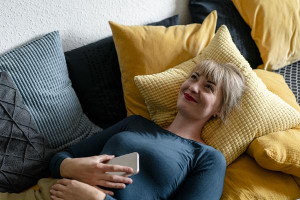 portrait of happy woman lying on
