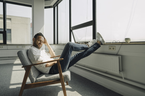mature businessman relaxing at the window