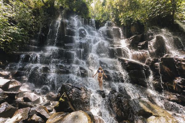 young woman near kanto lampo waterfall