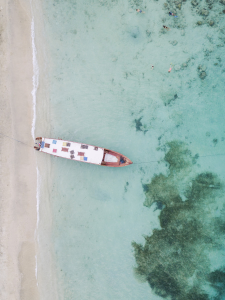 drone shot of boat moored at