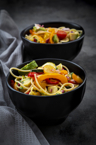 bowls of spaghetti with grilled vegetables