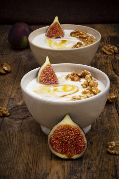 bowls of greek yogurt with honey