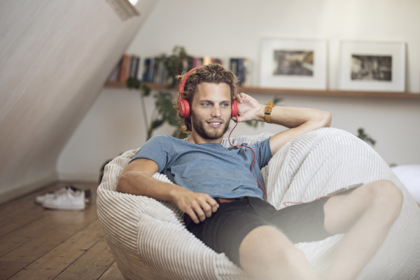 young man relaxing in beanbag at
