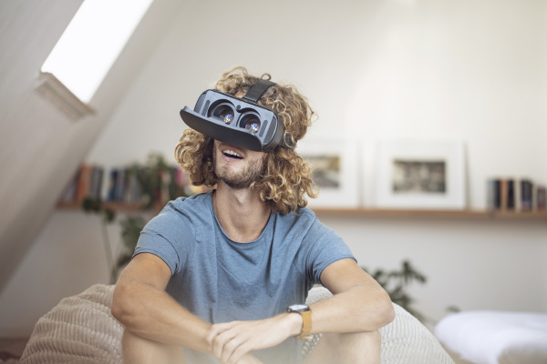 young man wearing vr glasses at