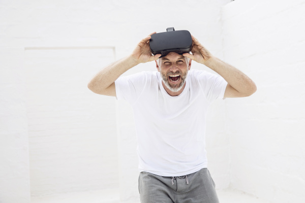 mature man with vr goggles
