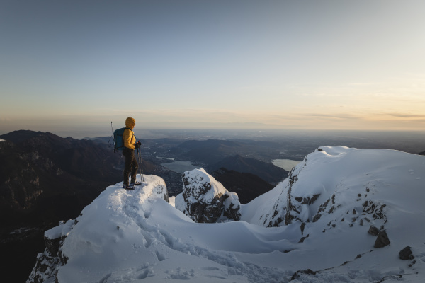 mountaineer standing on top of a