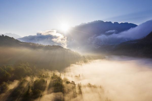 germany bavaria mittenwald rising sun illuminating