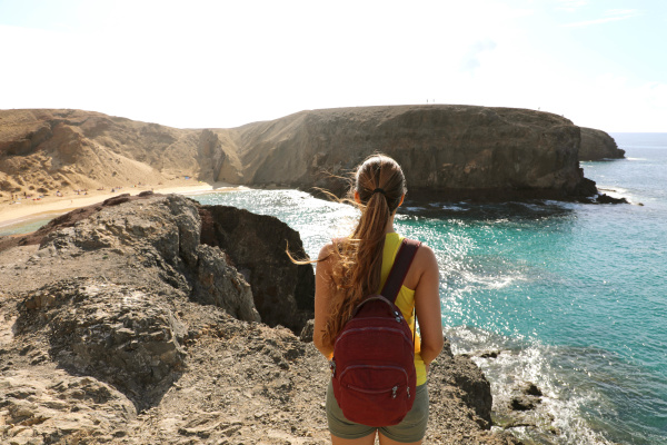female backpacker hiker on rocks enjoying