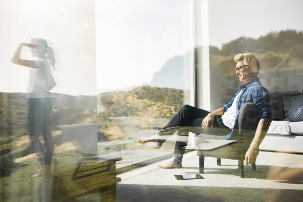 casual man sitting in modern home