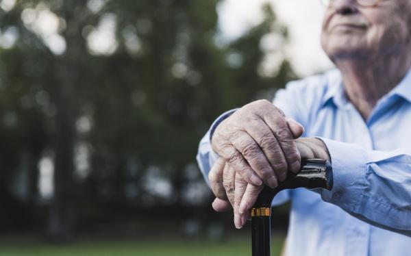 hands of senior man leaning on