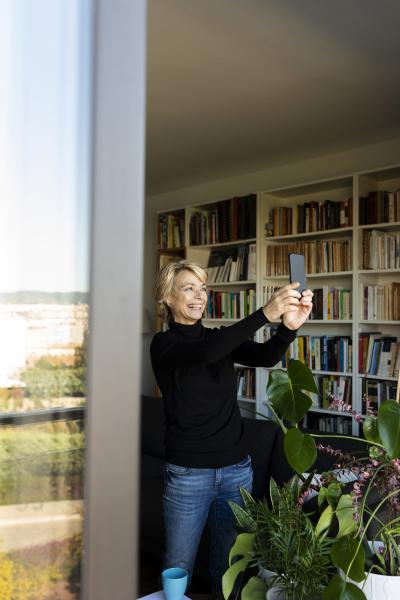 happy mature woman taking a selfie