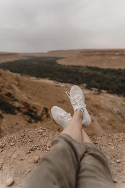 feet of woman enjoying landscape