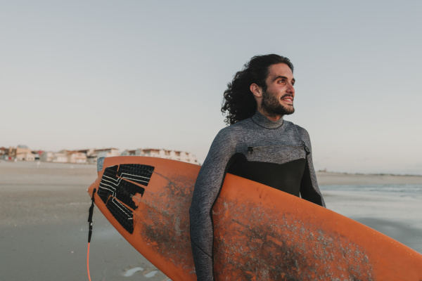 portrait of surfer on the beach