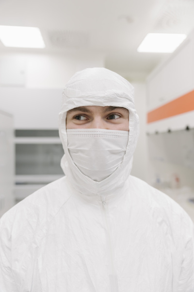 portrait of scientist wearing protective clothing