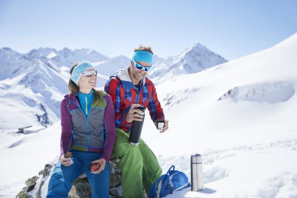 happy youple of ski tourers having
