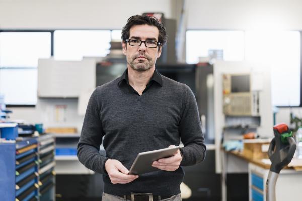 portrait of a businessman holding tablet