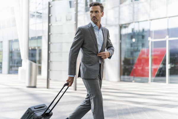 businessman with baggage on the go