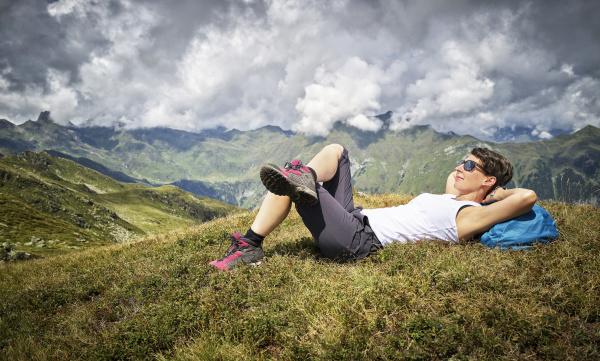 woman having a break from hiking