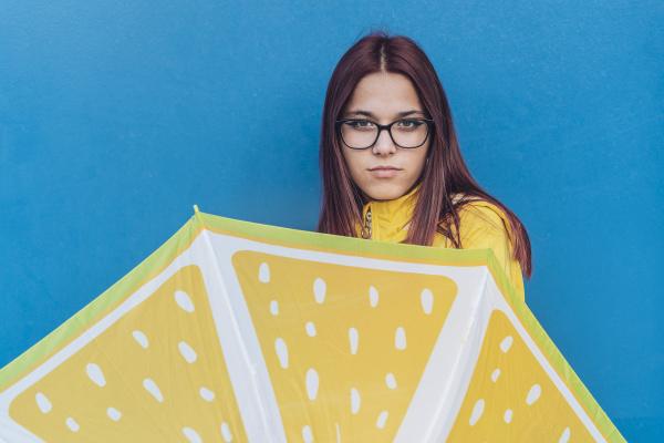 teenage girl wearing yellow rain jacket