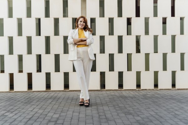businesswoman in white pant suit standing