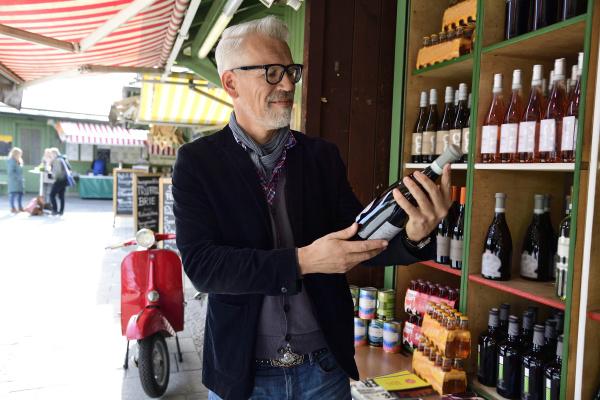 mature man choosing bottle of wine