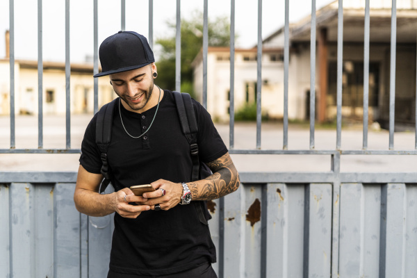 young man using his smartphone in