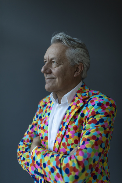 senior businessman wearing colorful sports jacket