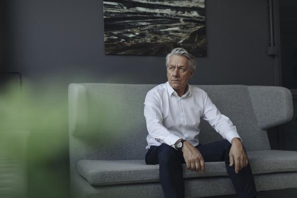 senior businessman sitting on a couch