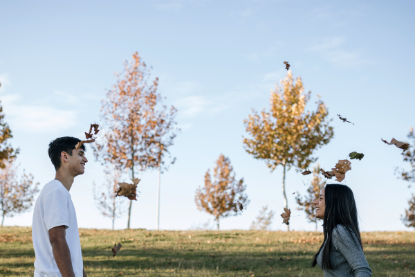 happy teenage couple on a meadow