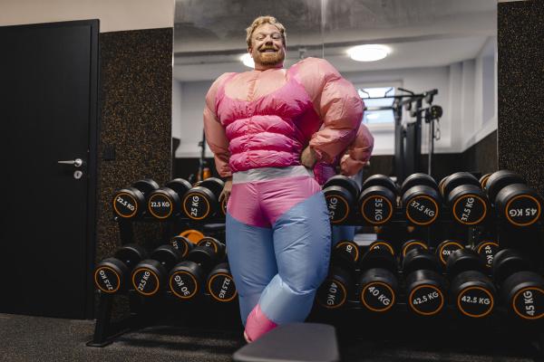 proud man wearing pink bodybuilder costume