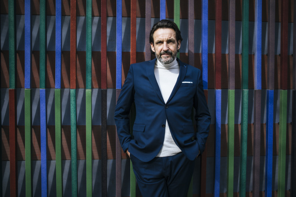 portrait of mature businessman wearing blue